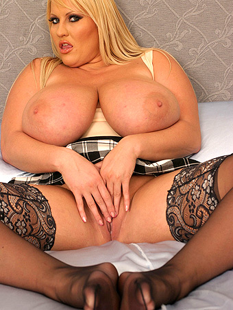 Laura M playing with her Huge tits in bed
